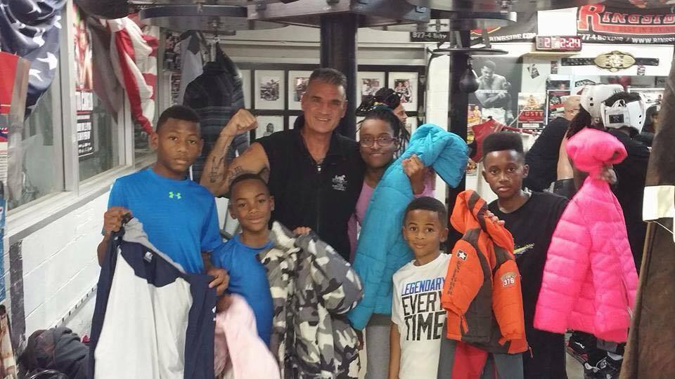 "Old School Boxing president Buddy Harrison with young students. ""They're all important to me,"" says Harrison."