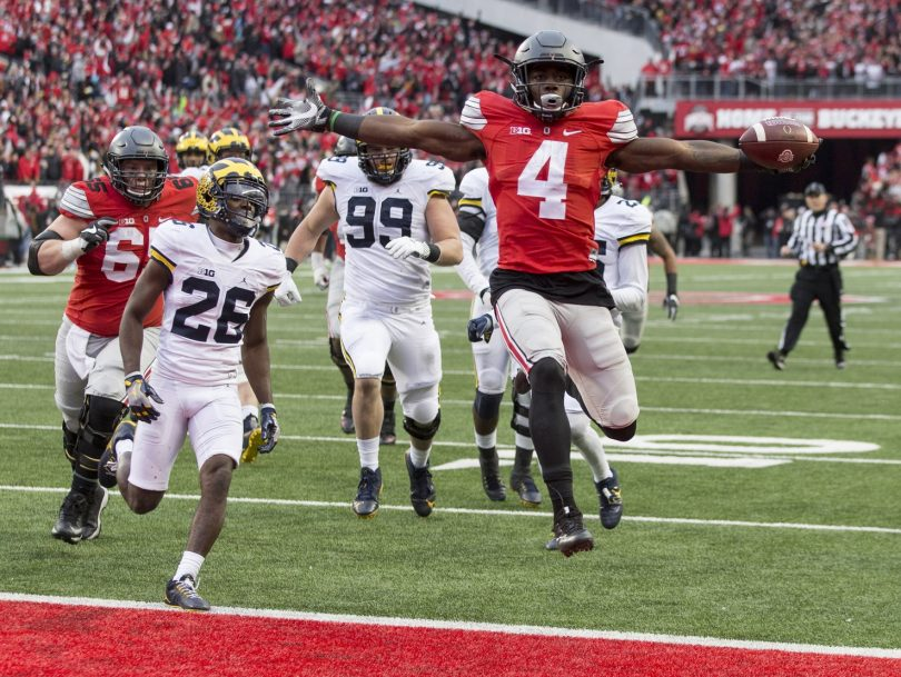 Ohio State Buckeyes running back Curtis Samuel (4) scores the winning touchdown in the second overtime under pursuit from Michigan Wolverines cornerback Jourdan Lewis (26) at Ohio Stadium. (Photo: Greg Bartram, USA TODAY Sports)