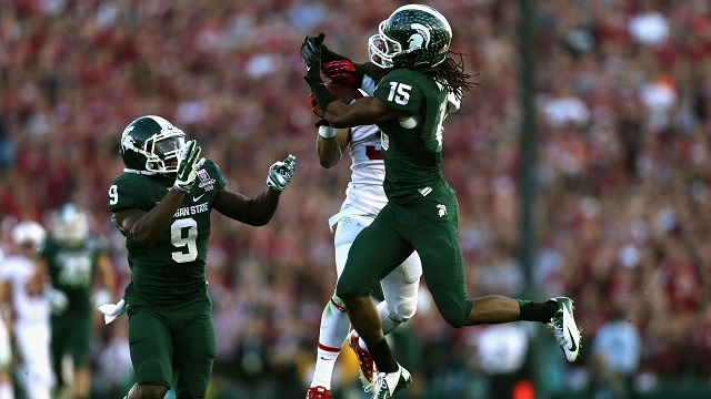 PASADENA, CA - JANUARY 01: Cornerback Trae Waynes #15 of the Michigan State Spartans makes an interception against the Stanford Cardinal in the third quarter of the 100th Rose Bowl Game presented by Vizio at the Rose Bowl on January 1, 2014 in Pasadena, California. (Photo by Jeff Gross/Getty Images)