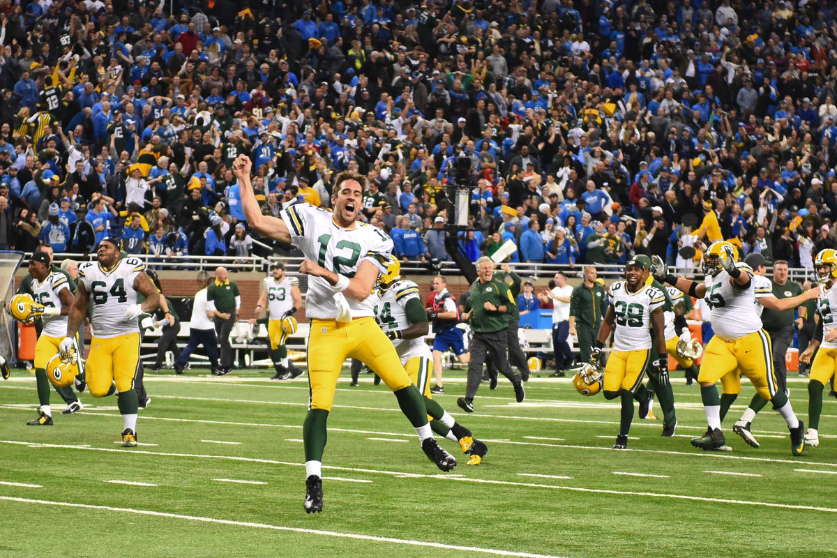 Dec 3, 2015; Detroit, MI, USA; Green Bay Packers quarterback Aaron Rodgers (12) celebrates after defeating the Detroit Lions at Ford Field. Green Bay won 27-23. Mandatory Credit: Tim Fuller-USA TODAY Sports