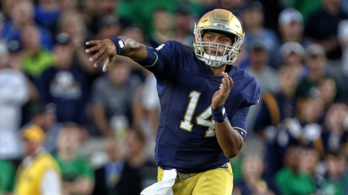 Kizer Throwing Football