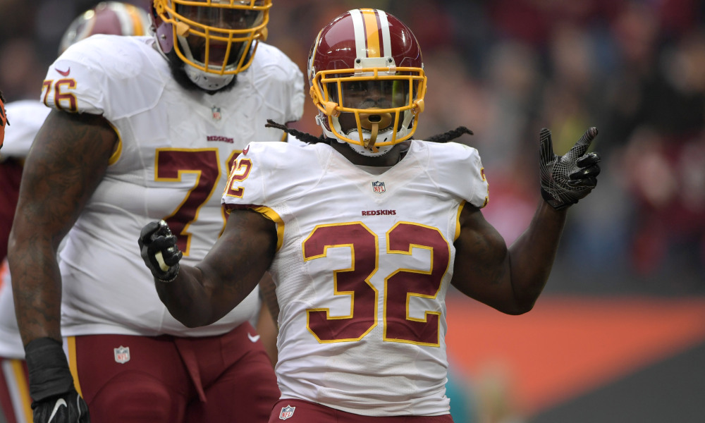 Oct 30, 2016; London, United Kingdom; Washington Redskins running back Robert Kelley (32) celebrates with tackle Morgan Moses (76) after scoring on a four-yard touchdown run in the first quarter against the Cincinnati Bengals during game 17 of the NFL International Series at Wembley Stadium. Mandatory Credit: Kirby Lee-USA TODAY Sports