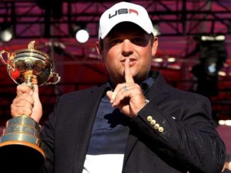 Patrick Reed holding trophy